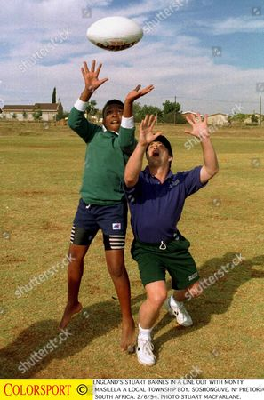 England' s Stuart Barnes in a line out with Monty Masilela a local township boy from Soshonguve Nr Pretoria 2/6/94 England' s tour to South Africa 1994 South Africa Pretoria