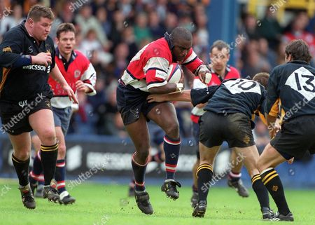 Stock Image of Steve Ojomoh (Gloucester) Alex King and Fraser Waters (13 for Wasps) Wasps v Gloucester 4/4/99 Great Britain London