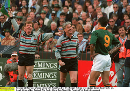 Referee Ed Morrison shares a joke with Joost Van Der Westhuizen (SA) as touch judge Derek Bevan looks on South Africa v New Zealand The Rugby World Cup Final Ellis Park 24/6/95 South Africa Johannesburg