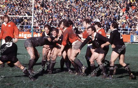 Ian Kirkpatrick Andy Haden and Lawrie Knight (New Zealand) guide the ball back to scrum half Lyn Davis (9) as Bill Beaumont (Lions) moves in New Zealand v British Lions 3rd Test Dunedin 30/07/1977 New Zealand Dunedin 3rd Test: NZ 19, Lions 7