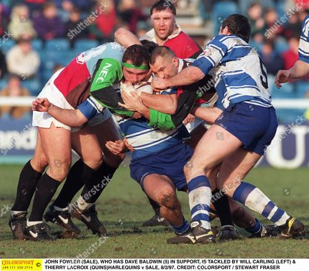 JOHN FOWLER (SALE) WHO HAS DAVE BALDWIN (5) IN SUPPORT IS TACKLED BY WILL CARLING (LEFT) & THIERRY LACROIX (QUINS)HARLEQUINS v SALE 8/2/97 Great Britain London