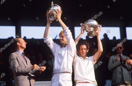 John McEnroe (right) and Peter Fleming hold aloft their doubles winning trophies Wimbledon 1984 Mens Doubles Final 1984 Centre Court 1984 Wimbledon Championships