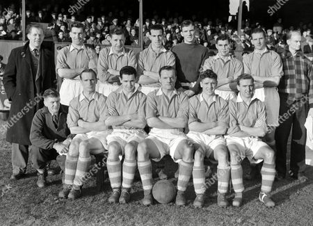 Stock Image of Workington Football Club 1951/52 Back row L to R A Flatley (Manager) M Andrew R Rooney R McAlone A Ford E Cushin L Hainsworth H Boult (Masseur) Front row : W Davey (tnr) J Maxfield D McDowall C Simmonds W Robson A Mullen