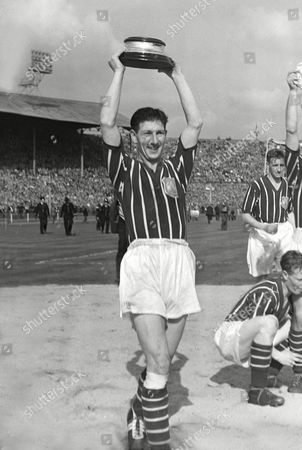 Roy Clarke (City) with the base of the trophy Manchester City v Birmingham City FA Cup Final 1956 at Wembley FA Cup Final: Man City 3 Birmingham 1