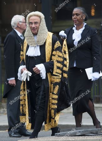 Lord Justice Leveson walks to the Houses of Parliament after attending their annual service at Westminster Abbey.