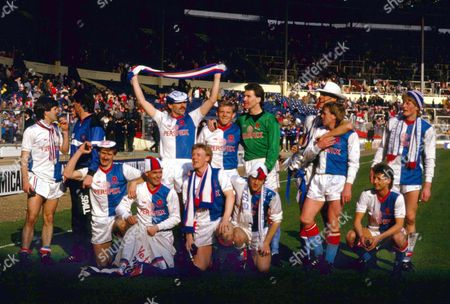 Blackburn Rovers team group celebrate victory Back row : L to R Chris Sulley Coach ? David Mail Mark Patterson Vince O'Keefe Glen Keeley (hat) Alan Ainscow Colin Hendry Front row : Ian Miller Chris Price Simon Barker Simon Garner Scott Sellars Blackburn Rovers v Charlton Athletic Full Members Cup Final 1987 Wembley 29/3/87 Full Members Cup Final: Blackburn 1 Charlton 0
