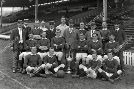 Manchester United team group Winners of the League Division One Championship trophy 1907/1908 Also winners of the first Charity Shield game in 1908 beating Queens Park RangersBack l-rat Ernest Mangnall (Secretary / Manager) F Bacon (trainer) Jack Picken Hugh Edmonds Mr Murray (director) Harry Moger John Henry Davies (Chairman) Tom Homer Mr Lawton (director) Alex Bell Mr Deakin (director) Middle: Billy Meredith Richard Duckworth Charlie Roberts Sandy Turnbull Enoch West George Stacey Ground Arthur Whalley Leslie Horton Harold Halse George Wall Div 1 Champions 1908: Manchester United
