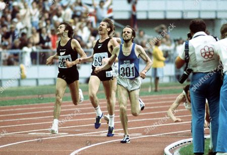 Athletics - 1976 Montreal Olympics - Men's 5000m Final Finland's Lasse Viren (301) wins the race with New Zealand's Dick Quax (691) taking silver in the Olympic Stadium Quebec Canada West Germany's Klaus-Peter Hildenbrand (falling right) has hurled himself over the line to snatch bronze from New Zealand's Rod Dixon (689 far left) By taking gold Viren became the only man to win the 5K/10K double twice at the Olympics 1976 Montreal Olympics