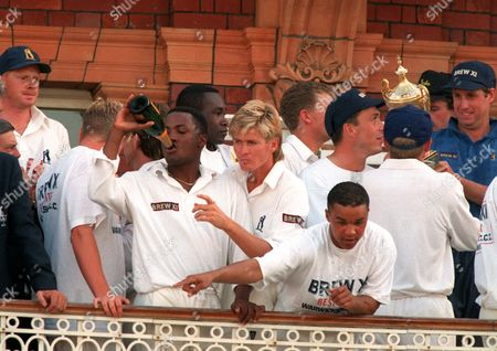 Warwickshire players celebrate victory Brian Lara swigs champagne; next to Trevor Penney; Keith Piper in front Gladstone Small (behind); Tim Munton (far right blue shirt) Warwickshire v Worcestershire Benson and Hedges Cup Final; Lords 09/07/1994 1994 B&H Final: Warwicks bt Worcs