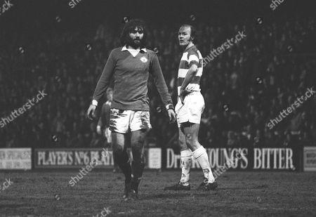 George Best (Utd) playing in his last game Terry Mancini (QPR) Queens Park Rangers v Manchester United Loftus road 1/1/1974 QPR 3 Man Utd 0