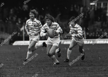 Rugby Union - 1974 Varsity Match - Oxford University 15 Cambridge University 16 Cambridge's Richard Breakey makes a break with teammates Richard Harding and Sandy Pratt in support at Twickenham 1974 Varsity Match: Oxford 15 Cambridge 16
