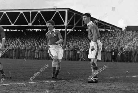 Wales players Noel Kinsey and Roy Clarke (right) Wales v Northern Ireland 1954 31/3/54 Wales v N Ireland