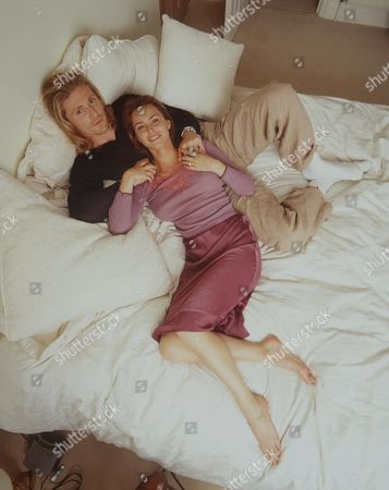 EMMANUEL PETIT AND AGATHE DE LA FONTAINE ON THEIR BED