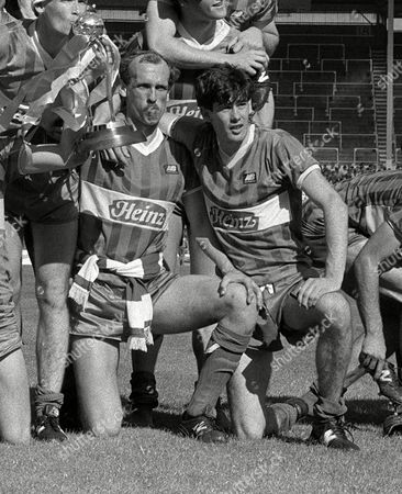 Mike Newell (Wigan) and Colin Methven celebrate with the trophy Wigan Athletic v Brentford Freight Rover Cup Final01/06/1985; Wembley