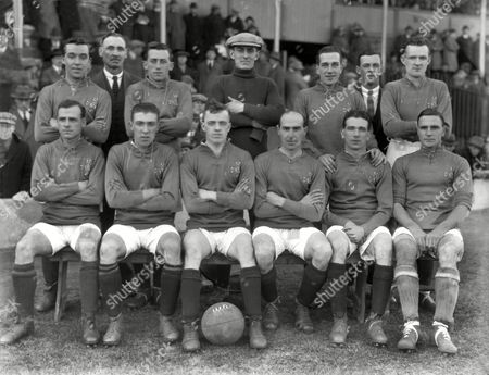 Football - 1923 British Home Championship - England 2 Ireland 0 Ireland Team Group before the game at The Hawthorns West Bromwich Back Row (left to right): Wiliam 'Billy' Emerson (Glentoran Burnley and Lindfield) trainer David Rollo (Linfield Blackburn Rovers and Port Vale) Alfred Harland (Linfield Everton and Runcorn John Curran (Glenavon Brighton and Linfield linesman Gerry Morgan (Linfield Nottingham Forest and Luton) Front: Davy Lyner (Glentoran Man United and New Brighton) Robert 'Bobby' Irvine (Everton Portsmouth Watford and Chester) Pat Nelis (Accrington Stanley Nottingham Forest and Wigan Borough) William 'Billy' Gillespie (Linfield Leeds City Sheffield United Derry City) James Burns (Glenavon Reading) Ernest 'Bert' Smith (Cardiff Middlesbrough and Watford) England 2 Ireland 0
