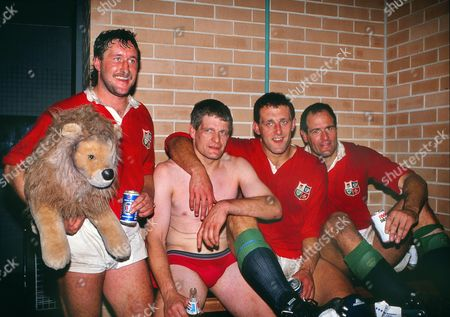 Rugby Union - 1989 British Lions Tour of Australia - Third Test: Australia 18 British Lions 19 Left to right Mike Teague (with Lion mascot) Finlay Calder Wade Dooley and Paul Ackford in the dressing room at Sydney after victory for the Lions which gave them the series 2-1 3rd Test: Australia 18 Lions 19