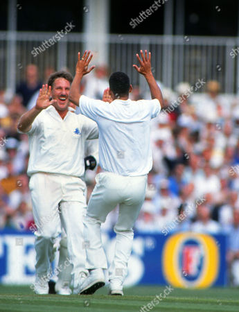 Cricket Ian Botham (Eng) celebrates with Phil Defreitas after another wicket England v West Indies 5th Test at the Oval Cricket ground 09/08/1991 5th Test: England v West Indies