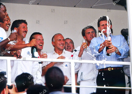 Cricket England CelebrationsL-r: 'Syd' Lawrence Phil DeFreitas Ian Botham Hugh Morris Micky Stewart (coach) physio Lawrie Brown Phil Tufnell and Robin Smith (with champagne) England v West Indies 13/08/1991 Oval Cricket ground 1991 5th test 5th Test: England v West Indies