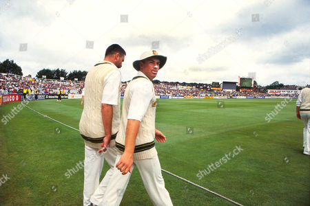 Cricket - 1993 Ashes Series Second Test - England vs Australia Australian players Shane Warne (right) and Merv Hughes walk onto the playing area at Lords 1993 Ashes: 2nd Test
