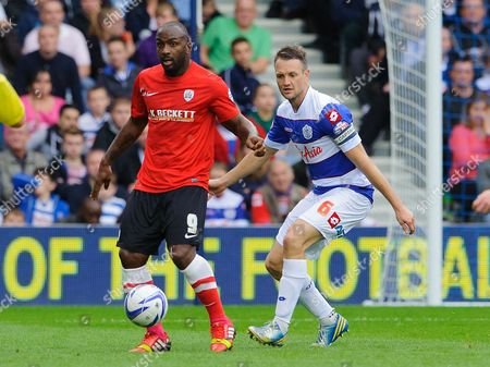 Stock Picture of Jason Scotland of Barnsley and Clint Hill of QPR