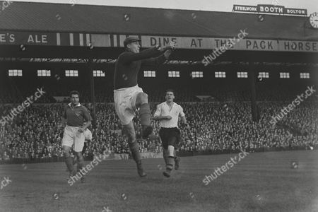 Football - 1950 / 1951 First Division - Bolton Wanderers 4 Portsmouth 0 Portsmouth goalkeeper Ernie Butler with Harry Ferrier left and Nat Lofthouse right at Burnden Park 07/10/1950 Bolton 4 Portsmouth 0