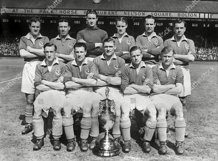 Stock Photo of Football - First Division 1948 / 1949 - Bolton Wanderers 1 Portsmouth 2 (23/04/1949) This was the game that gave Portsmouth their first League title as Man United and Newcastle both drew Portsmouth Team Group - League ChampionsBack row (left to right): Jimmy Scoular Wally Hindmarsh Ernie Butler Jimmy Dickinson Reginald Flewin Harry Ferrier Front: Peter Harris Ike Clarke Douglas Reid Len Phillips Jack Froggatt The photographer has added in the English Football League Championship trophy ('The Lady') Bolton 1 Portsmouth 2