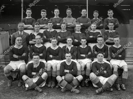 Football - 1930 / 1931 season - Nottingham Forest Full Squad Team Group Back (left to right): H S Smith John Dent A Farmer P Ashton A Dexter A E Quantrill W Thompson Second Row: D Willis (trainer) C Howie Armstrong Dickinson Graham Raynor Cameron Sitting: R S Wallace N Burton A Coyles W McKinlay J Loftus R Heslop W Simpson Ground: J Scott J Barrington O M Brown Nottingham Forest - 1930/31