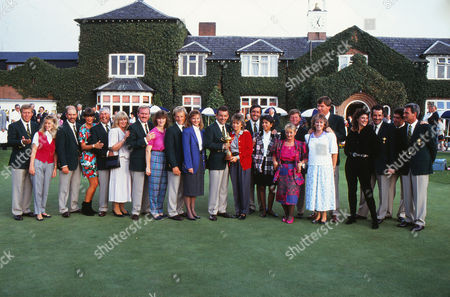 Golf - 1989 Ryder Cup - The Belfry The European team pose in front of the clubhouse with their wives The contest with the USA ended in a 14-all draw meaning that Europe retained the trophy they had won outright two years earlier Left to right: Howard Clark Christy O'Connor Jnr Ronan Rafferty Bernhard Langer Tony Jacklin (captain) with the trophy Severiano 'Seve' Ballesteros Ian Woosnam Nick Faldo Sam Torrance Jose Maria Olazabal Gordon Brand Jnr 1989 Ryder Cup