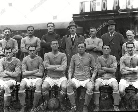 Stock Image of Football - 1920 / 1921 season - Cardiff City Team Group Back l-r: Fred Keenor B Smith Ben Davies (goalkeeper) J Stewart (manager) Jack Page Unknown Hardy Front : W Grimshaw J Gill ---- ---- ----- ---- Cardiff City - 1920/1