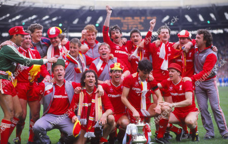 Football - 1986 FA Cup Final - Liverpool 3 Everton 1 The Liverpool team celebrate with the trophy after the match at Wembley Standing (left to right): Bruce Grobelaar Kenny Dalglish Gary Gillespie Jan Molby Paul Walsh Mike Hooper Sammy Lee Mark Lawrenson Ian Rush Kevin MacDonald Ronnie Whelan John Wark Ground: Steve McMahon Craig Johnstone Jim Beglin Alan Hansen Steve Nicol 1986 FA Cup Final: Liverpool 3 Everton 1
