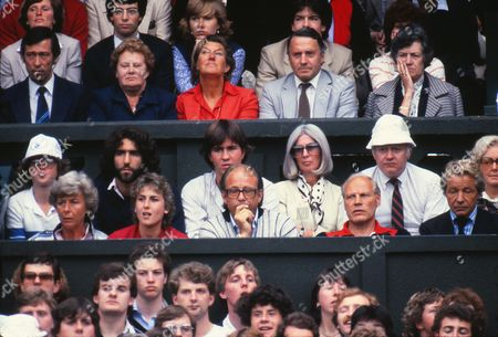 Tennis - 1981 Wimbledon Championships - Men's Singles Final John McEnroe's and Bjorn Borg's familes watch the match on Centre Court McEnroe's parents are in the middle row far right (white hat and long grey hair) while Borg's wife Mariana Simionescu is in red in the row in front next to his coach Lennart Bergelin McEnroe won the match 4-6 7-6 7-6 6-4 1981 Wimbledon Men's Final