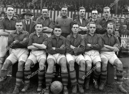 Stock Picture of Football - 1928 / 1929 season - Merthyr Town Football Club Team Group Back (left to right): Richards Mr Gibbons (Manager) Jack Page McKenna Scott W Michael (trainer) Crewe Front: Brown Jones Gibbons (18 year old centre forward) Featherby Borland Beever (captain) Merthyr Town - 1928/29