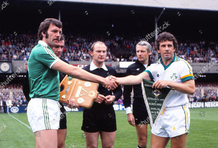 Football - UEFA EURO 1980 Qualifying - Group One: Republic of Ireland 0 Northern Ireland 0 The Irish captains shake hands before the game: the Republic's Johnny Giles (right) and Alan Hunter at Lansdowne Road Dublin Rep of Ireland v Northern Ireland