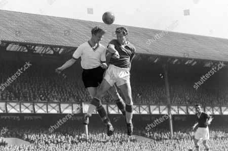 Football - 1959 / 1960 First Division - Everton 1 Leeds United 0 Everton's James Harris and Leeds' Jack Charlton compete for a header at Goodison Park Everton 1 Leeds 0
