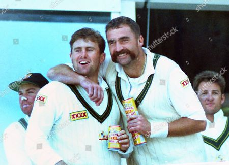Cricket - 1993 Ashes 4th Test - England vs Australia Captain Mark Taylor and bowler Merv Hughes celebrate after winning the match by an innings and 148 runs at Headingley and taking an unassailable 3-0 lead in the series 1993 Ashes: 4th Test