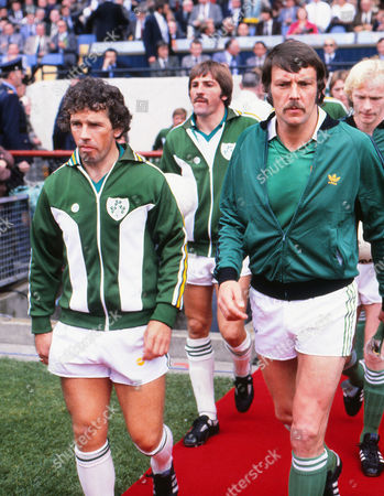 Football - UEFA EURO 1980 Qualifying - Group One: Republic of Ireland 0 Northern Ireland 0 The Irish Captains: the Republic's Johnny Giles (left) walks out with Alan Hunter at Lansdowne Road Dublin Rep of Ireland 0 Northern Ireland 0