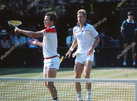 Tennis - 1984 Wimbledon Championships - Men's Doubles Final Peter Fleming and John McEnroe on Centre Court They defeated Pat Cash and Paul McNamee 6-2 5-7 6-2 3-6 6-3 1984 Wimbledon Championships