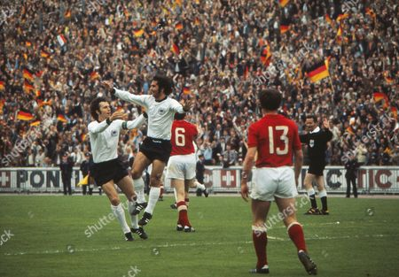 Football - 1972 UEFA European Championship - Final: West Germany 3 Soviet Union 0 (18/06/1972) West Germany's Gerd Muller right celebrates his goal with captain Franz Beckenbauer during the game in Heysel Stadium Brussels Belgium Euro72 Final: W Germany 3 USSR 0