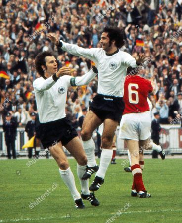 Football - 1972 UEFA European Football Championship - Final: West Germany 3 Soviet Union 0 - 18/06/1972 West Germany's Gerd Muller celebrates his goal with teammate Franz Beckenbauer in the Heysel Stadium Brussels Euro72 Final: W Germany 3 USSR 0