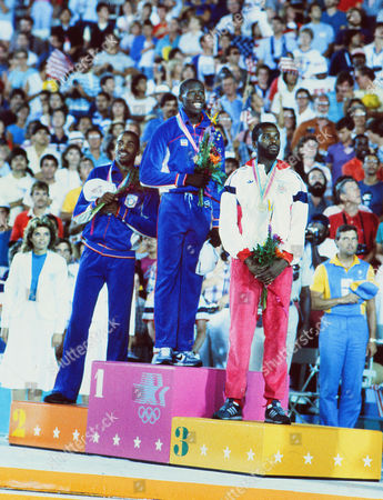 Athletics - 1984 Los Angeles Olympics - Men's Triple Jump Medal Presentation The triple jump podium in the Los Angeles Memorial Coliseum Left to right: USA's Mike Conley (silver) USA's Al Joyner (gold) and Great Britain's Keith Connor (bronze) 1984 Los Angeles Olympics - Men's Triple Jump