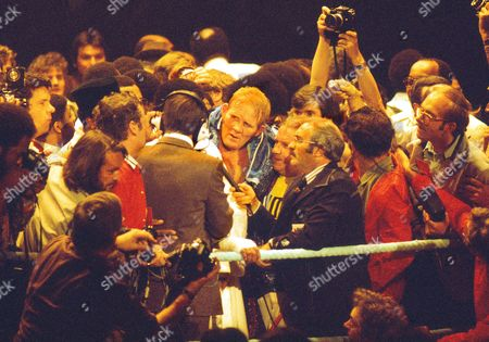 ITV Boxing commentator Reg Gutteridge interviews Ali after the fight in the ring as Richard Dunn looks on Muhammad Ali v Richard Dunn World Heavyweight Championship Title fight Munich 25/05/1976 Ali v Dunn (Munich)