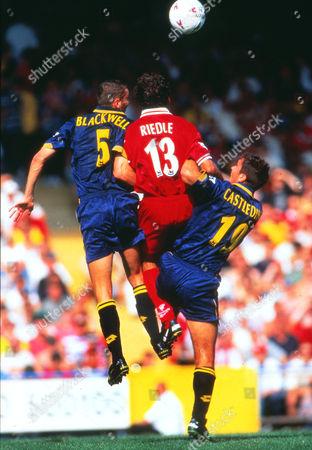 Stewart Castledine and Dean Blackwell (Wimbledon) Karl Heinz Riedle (Liv) Wimbledon v Liverpool 09/08/1997 Wimbledon v Liverpool
