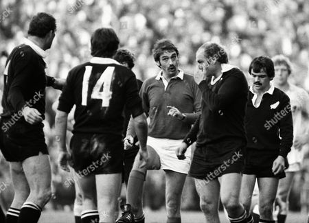 Stock Photo of Rugby Union - 1979 New Zealand Tour of England Scotland and Italy - England 9 New Zealand 10 Referee Norman Sanson of Scotland has a word with All Black John Spiers and Brian Ford (#14) at Twickenham England 9 NZ 10