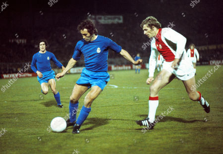 Football - 1972 / 1973 European Cup - Semi-Final First Leg: Ajax 2 Real Madrid 1 Madrid's Amancio Amaro on the ball with Ajax's Piet Keizer right at the Olympisch Stadion Amsterdam the Netherlands 11/04/1973 EC SF1: Ajax 2 R Madrid 1