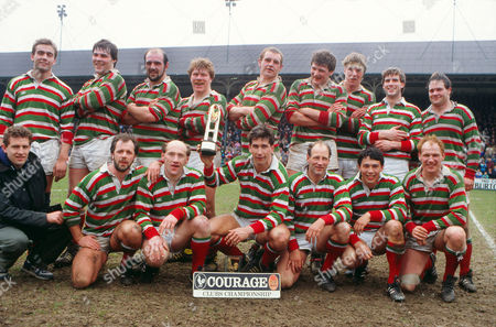 Rugby Union - Courage Clubs Championship 1988 - Leicester vs Waterloo Leicester team celebrate winning the title Back Row (L to R): Ian Bates John Wells Wayne Richardson Stuart Redfern Dean Richards Malcolm Foulkes-Arnold Tom Smith Barry Evans Harry Roberts Front: Steve Burnhill (Sub) Steve Kenney Les Cusworth Paul Dodge (with trophy) Dusty Hare Rory Underwood Peter Thornley Leicester v Waterloo