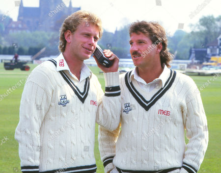 Stock Photo of Cricket - Worcestershire County Cricket Club Photocall 1987 Graham Dilley and Ian Botham pose with a mobile phone