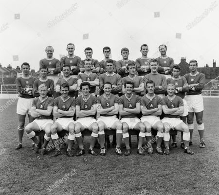Football - 1963 / 1964 season - Gillingham Team Group 1964 Fourth Division Champions Back (left to right): Don Campbell Jimmy White Roy Moss Bob Ridley Peter Godfrey John Ballagher Terry Stacey Middle: Rodney Taylor Roger Challis Geoff Hudson Mike Burgess John Simpson Dennis Hunt Dave Huddart Brian Yeo Bobby Smith Front row: Nobby Newman John Arnott Brian Gibbs George Francis Peter Stringfellow Alec Farrall Gordon Pulley Gillingham F.C - 1963/4 Fourth Division Champions