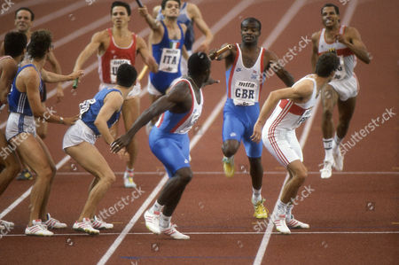 Athletics - 1990 Split European Championships - Men's 4 x 400 metres relay Final Great Britain's Kriss Akabusi hands over the baton to teammate John Regis on the way to winning gold in Split Yugoslavia 1990 Split European Championships: Men's 4x400m