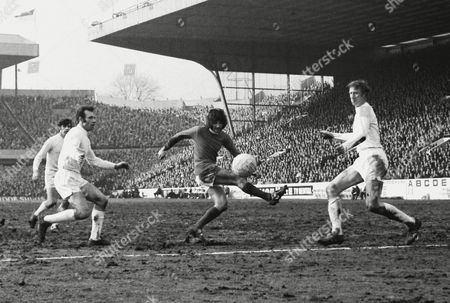 Football - 1969 / 1970 FA Cup - Semi-Final: Manchester United 0 Leeds United 0 Manchester's George Best and Leeds' Paul Reaney left and Jack Charlton right at Hillsborough FA Cup SF: Man Utd 0 Leeds 0