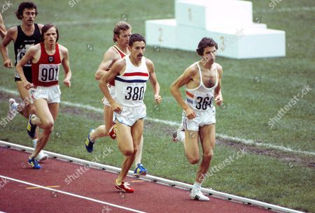 Athletics - 1976 Montreal Olympics - Men's 5000m Final Great Britain's Brendan Foster (#364) and Ian Stewart (#380) with the USSR's Enn Sellik (#901) and New Zealand's Rod Dixon (far left) in the Olympic Stadium Quebec Canada Foster went on to finish in fifth place Stewart seventh Sellik eleventh and Dixon fourth 1976 Montreal Olympics - Men's 5000m